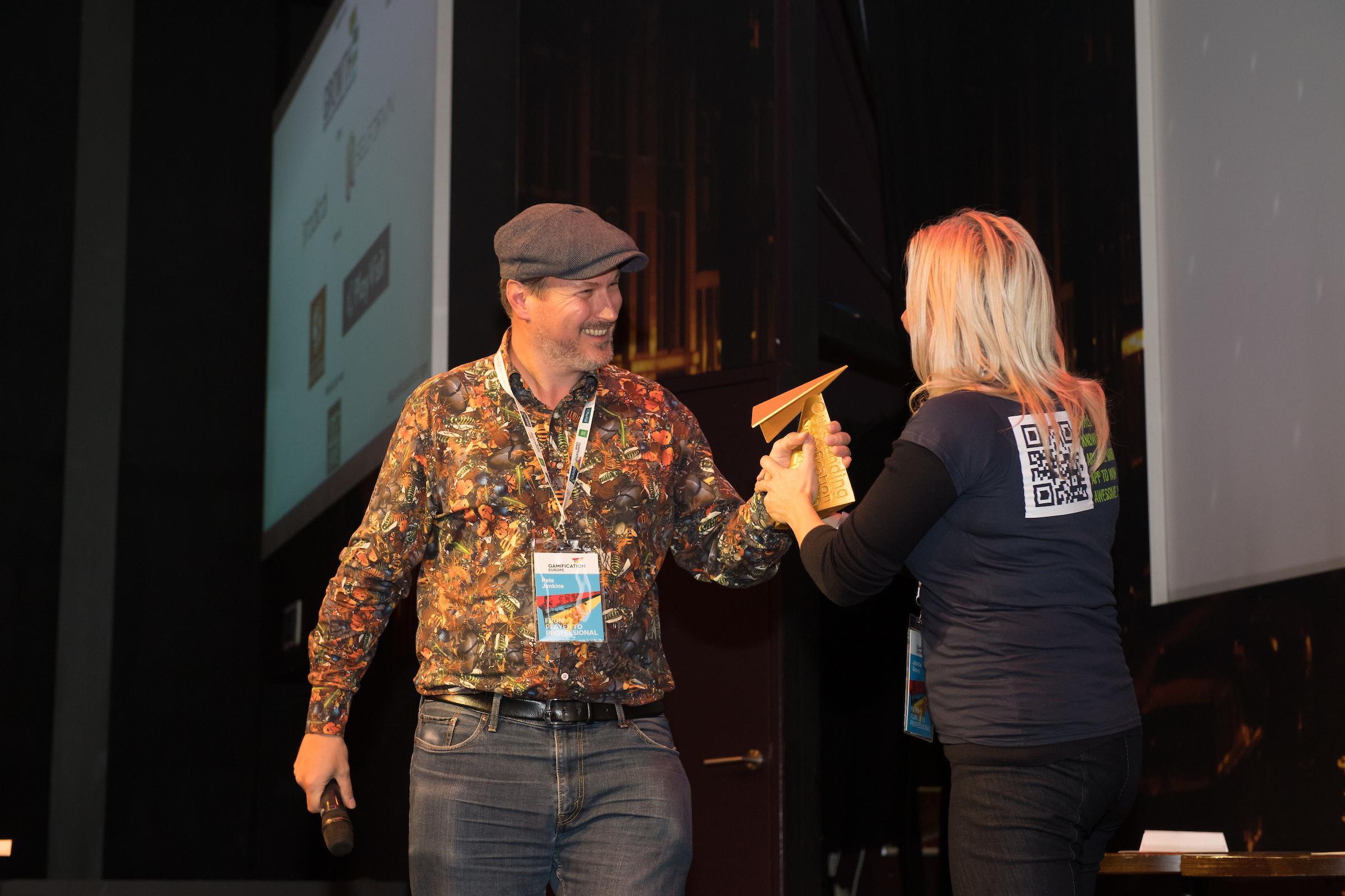 Handing over an award.